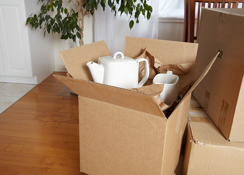 A moving box with tea supplies