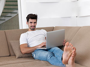 Gentleman on Laptop in Furnished Apartment