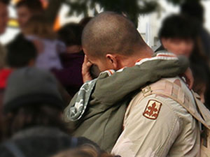 Military Family Reuniting with Hugs